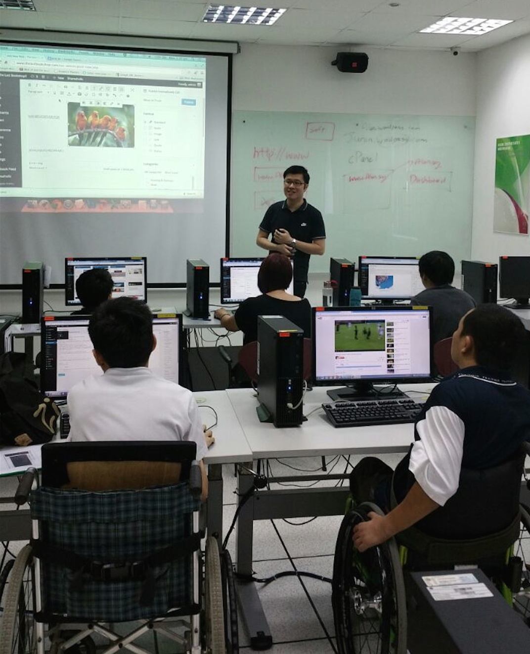 Our principal trainer teaching web designing to the physically challenged.